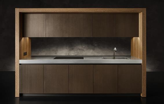 The hob and sink from the Armani Bridge kitchen are placed in a wooden compartment