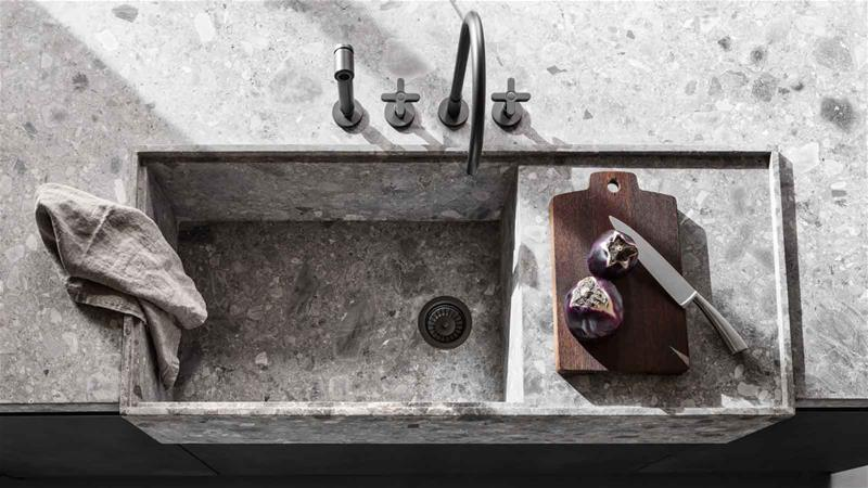 close up of the stone washbasin of the VVD kitchen one of the best modern italian kitchens